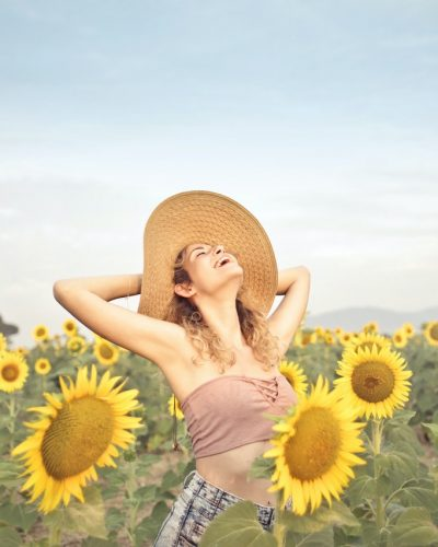 woman-standing-on-sunflower-field-3764579